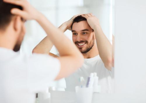 man touching hair